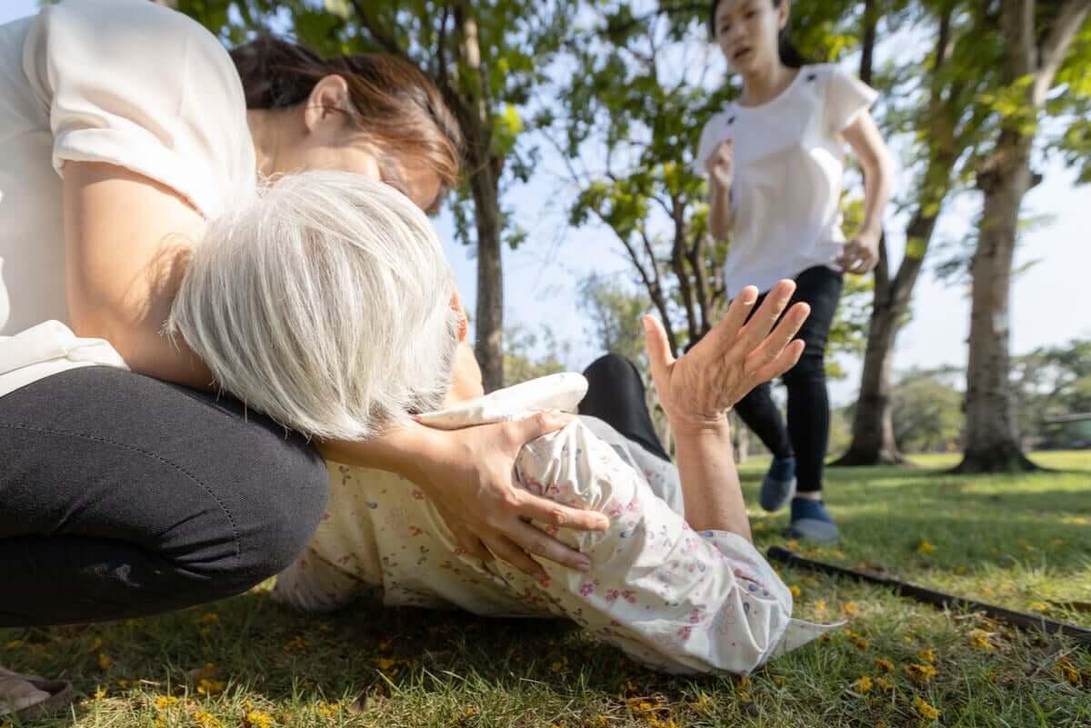 A fainted woman in a park