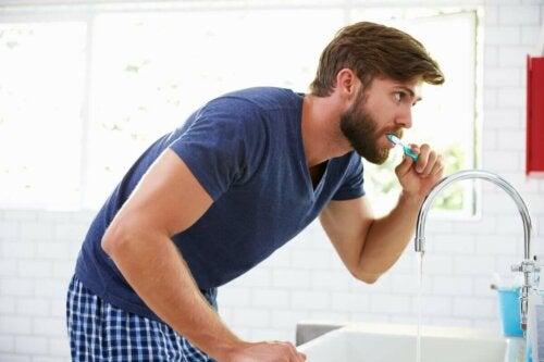 A man brushing his teeth.