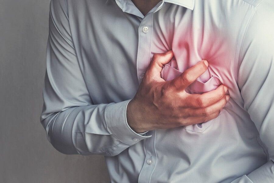 A man grabbing his chest.