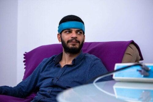 A man undergoing a stress relaxation technique.