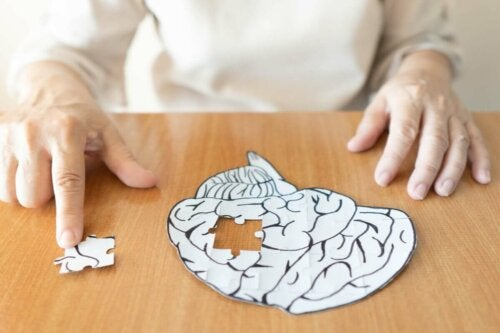 A person piecing a brain puzzle together.