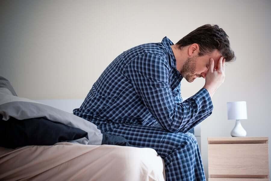 A stressed man in pijamas.