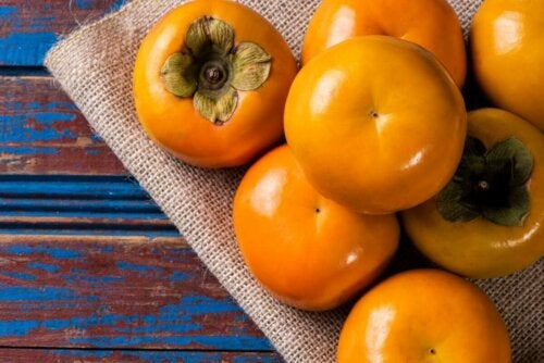 Persimmons on a surface.
