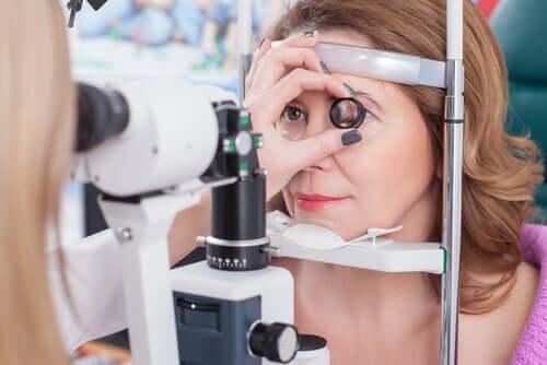 A woman undergoing eye testing.