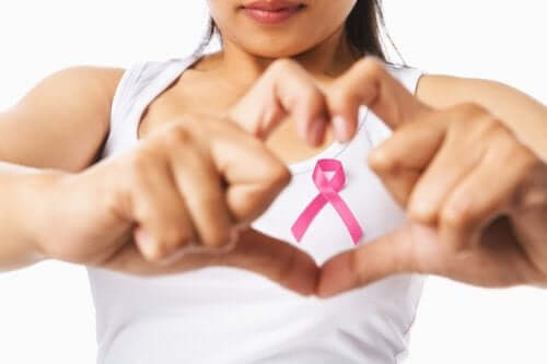 A woman with a breast cancer ribbon