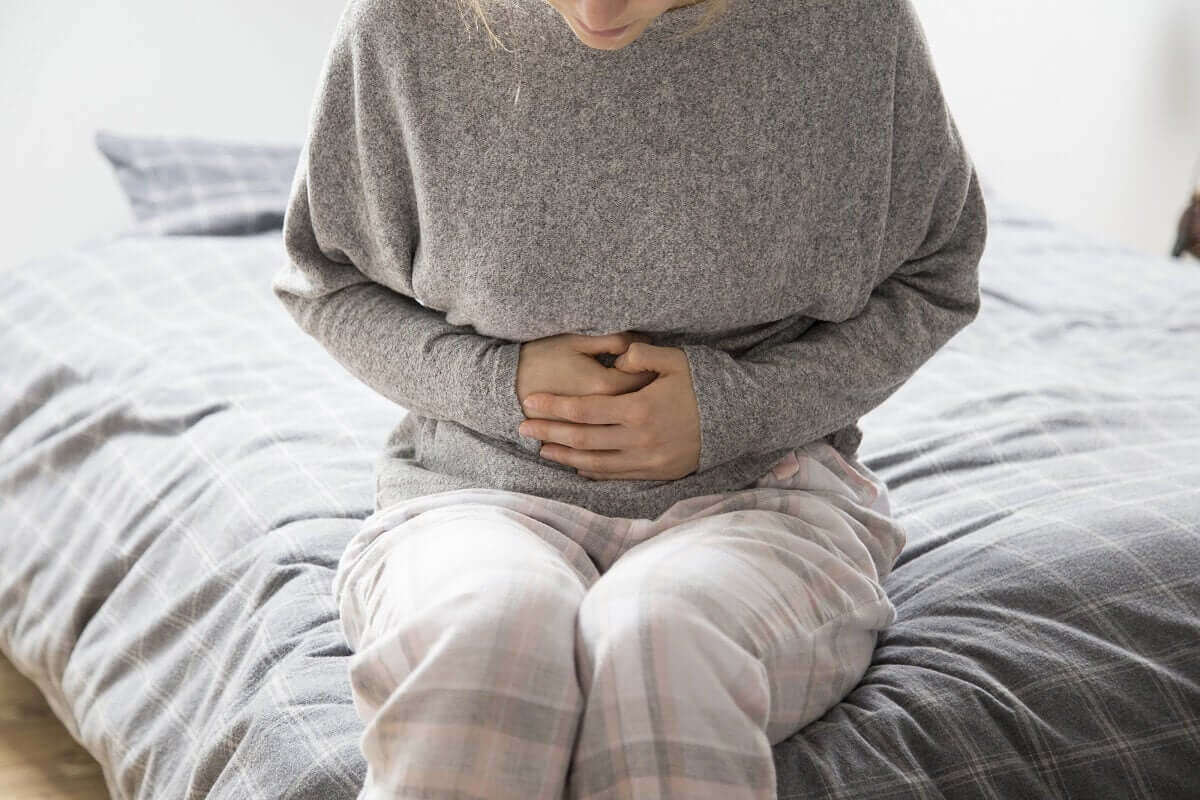 A woman with stomach pain.