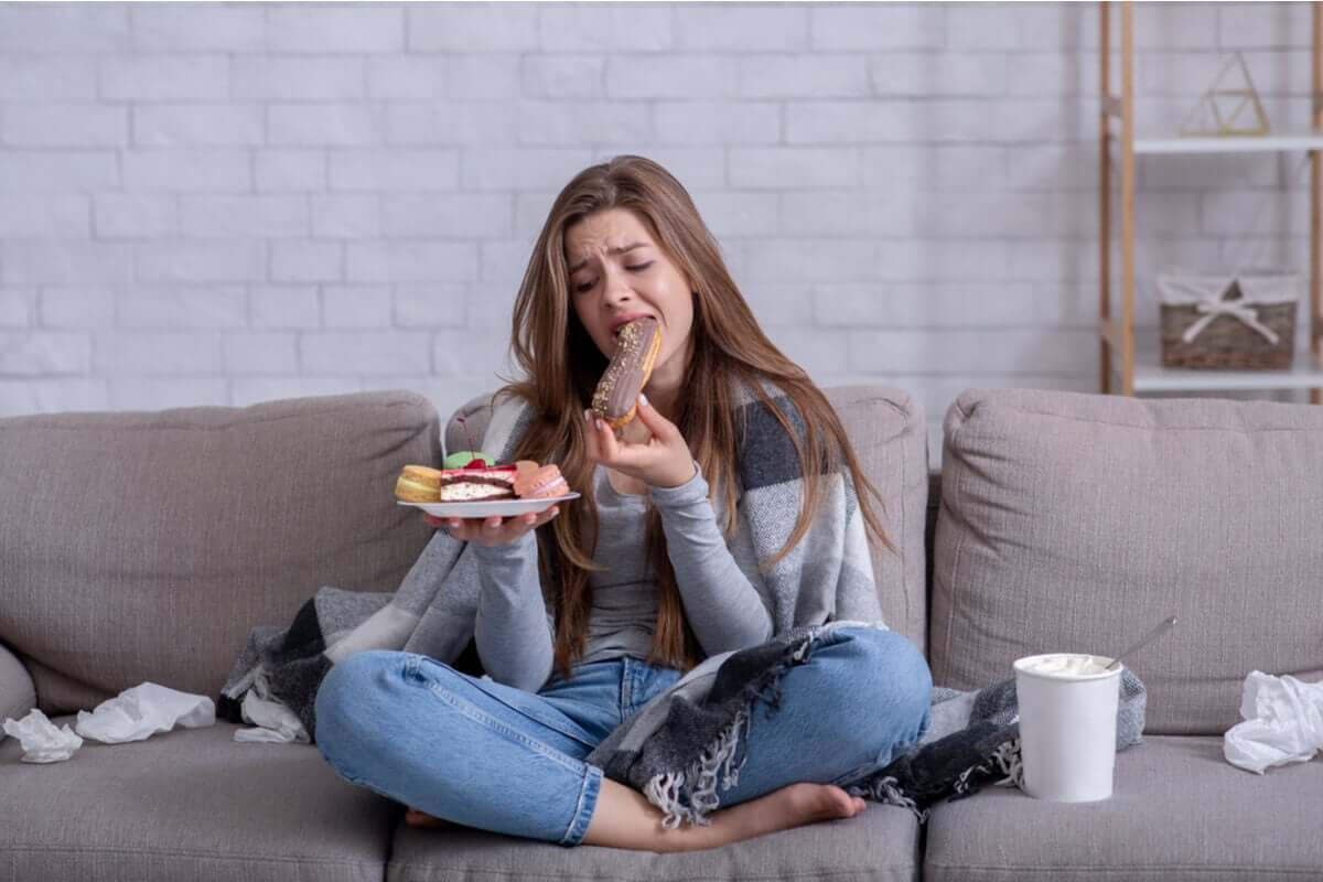 A woman crying and eating.