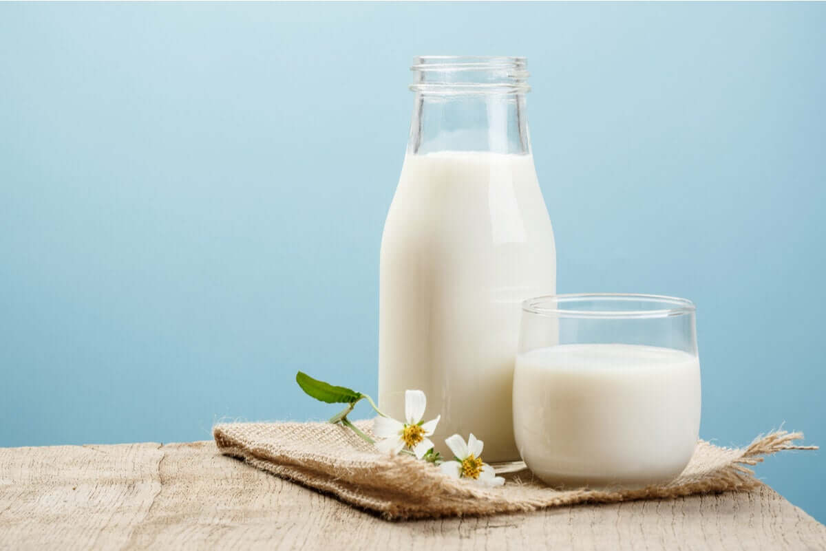 A jar of milk and a glass of milk.