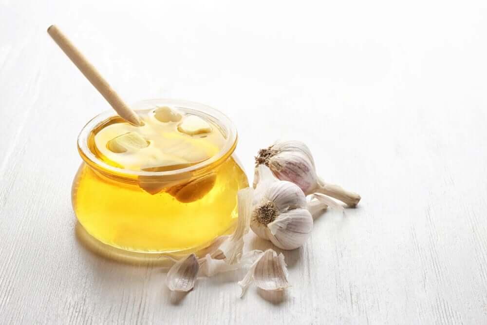 A jar of honey and garlic.