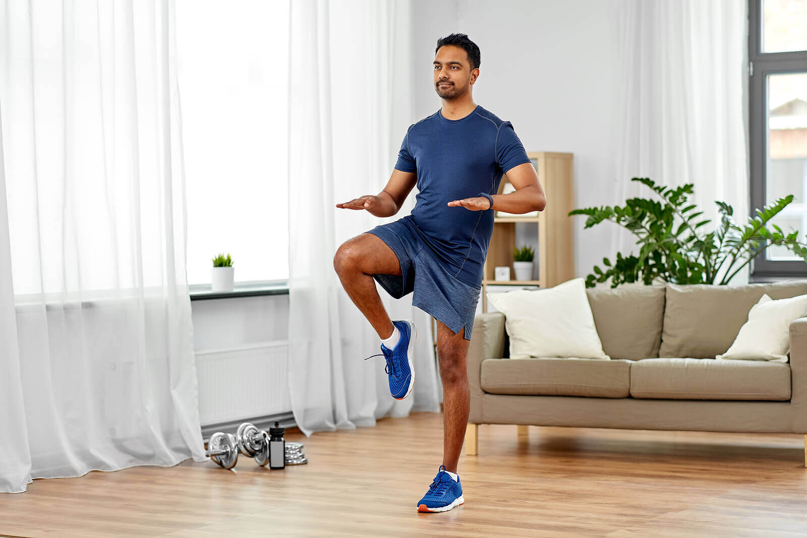 A man exercising in his living room.