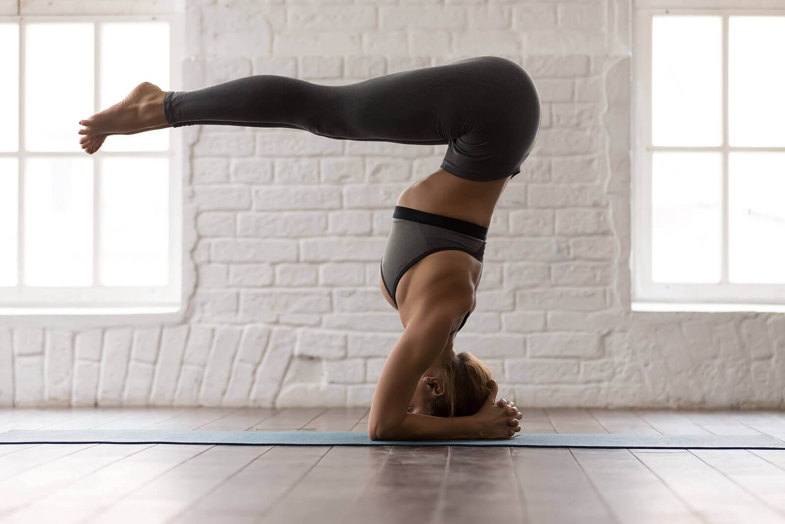 A woman performing a yoga pose.