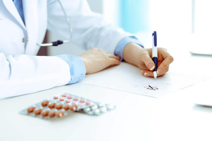 A female doctor writing a prescription.