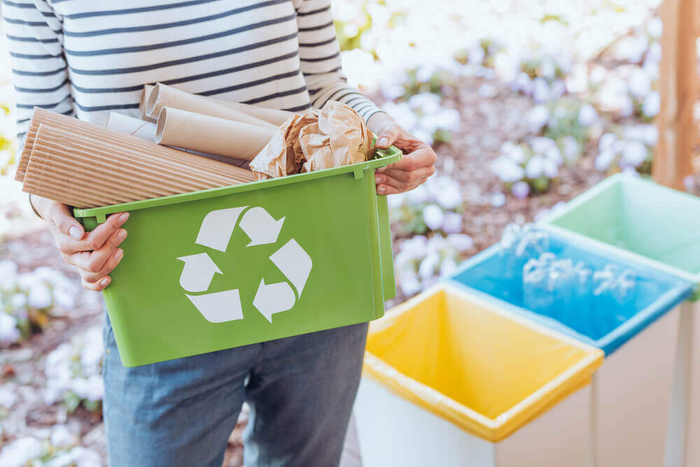 A woman sorting her recycleable.