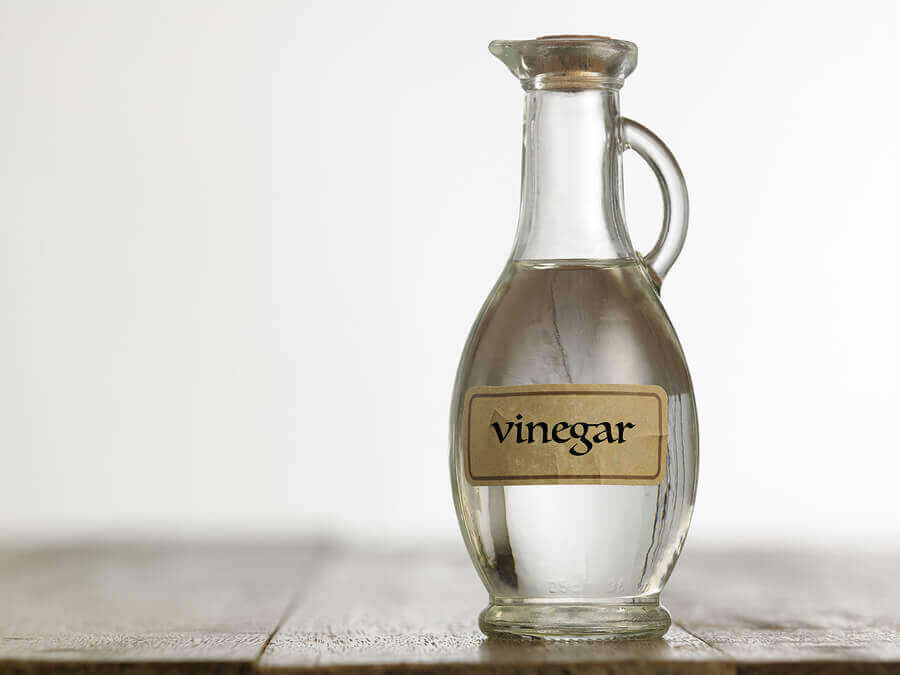 A glass container of vinegar.