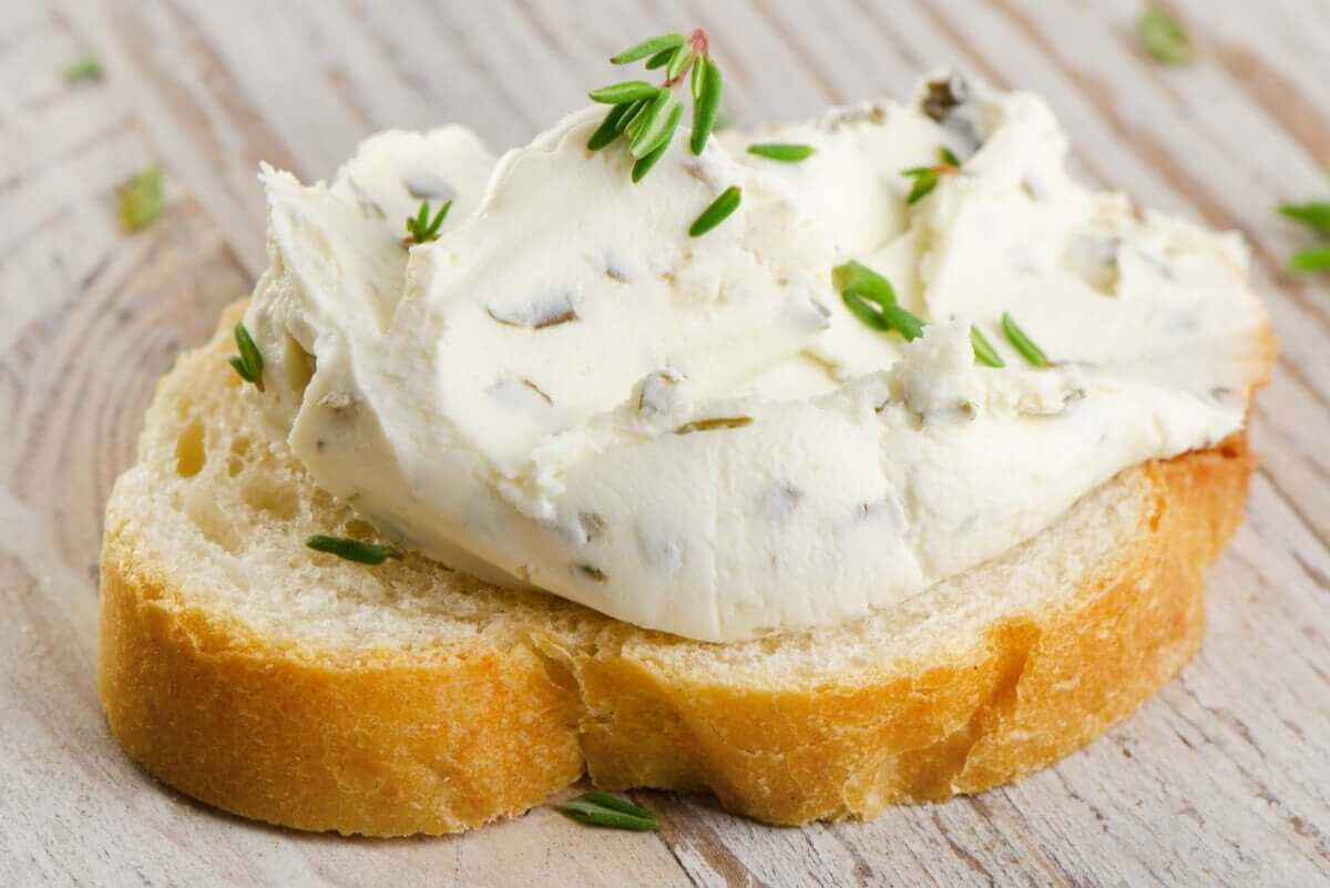 A slice of toast with cream cheese.