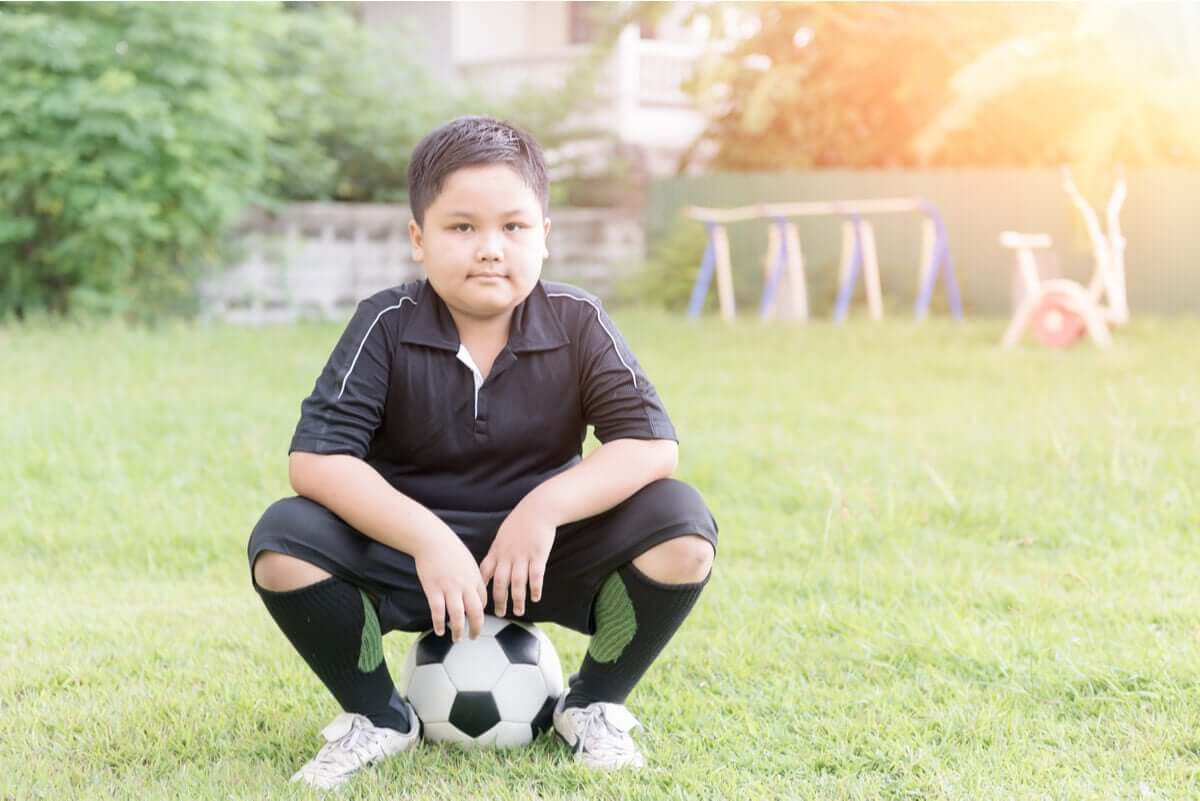 A child playing soccer.