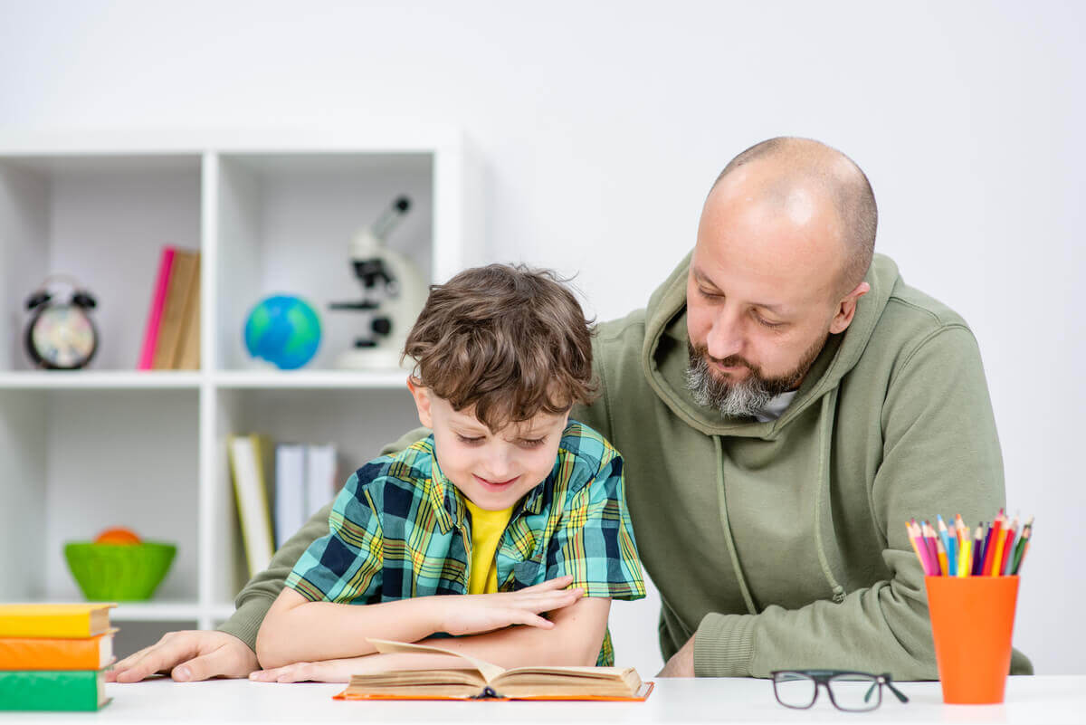 A father doing homework with his son.