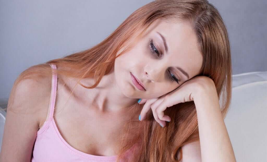 A woman who's feeling exhausted because her iron's low.