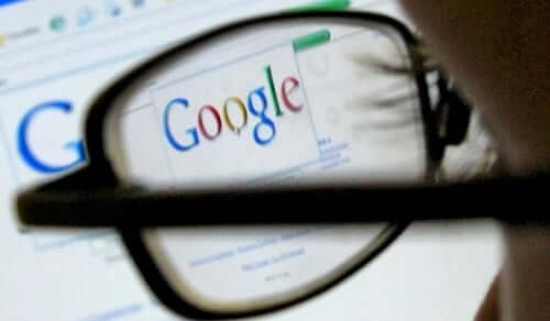 A woman conducting a search on google.
