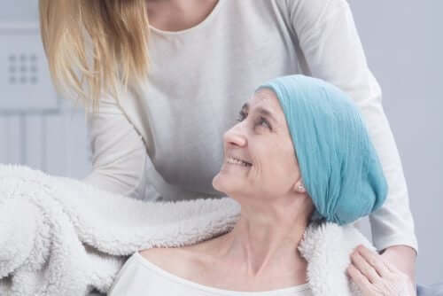 A woman caring for a woman with breast cancer.