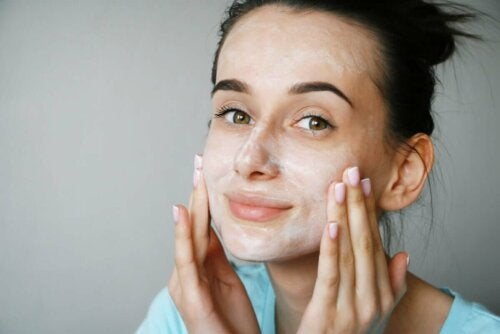 A woman with a face cream on.