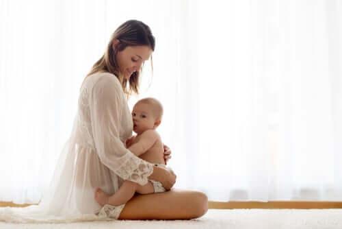 A baby breastfeeding.