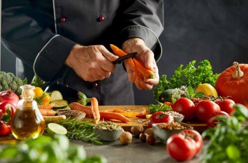 A person peeling carrots.