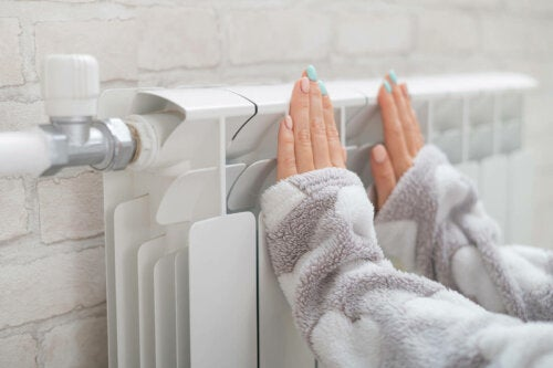 A person warming their hands.