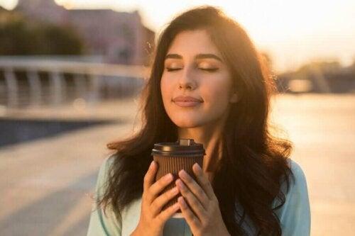 A woman enjoying her coffee.