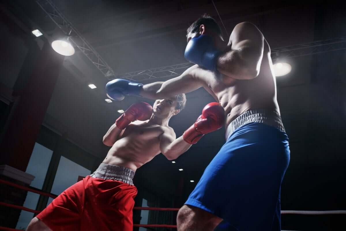 Two men boxing.