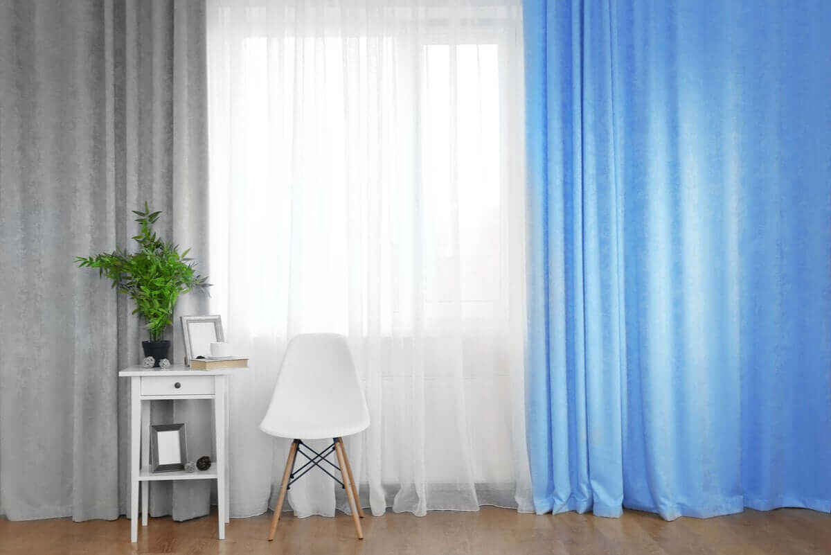 grey, white, and blue curtains in the same room.