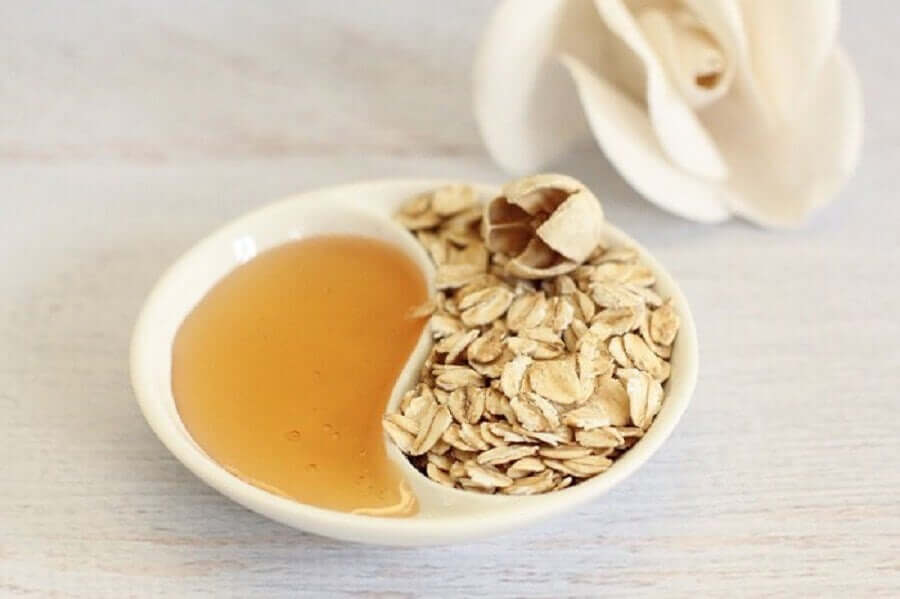 A dish containing honey and oats.