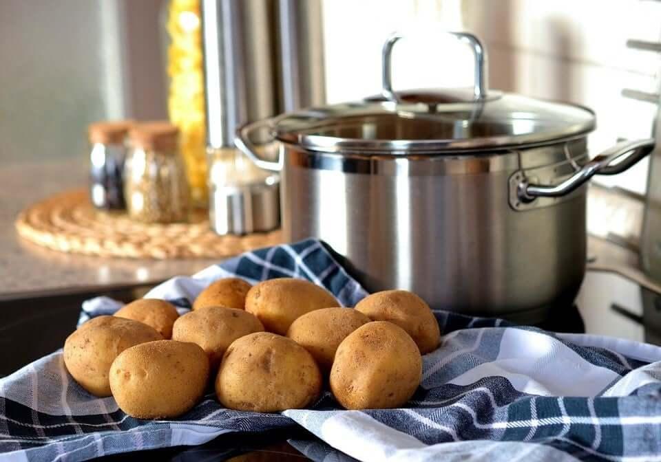 Potatoes next to a pot.