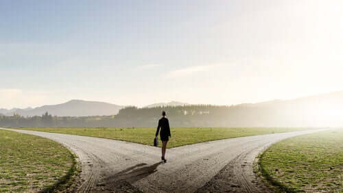 A woman at a crossroads.