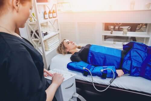 A woman undergoing pressotherapy.