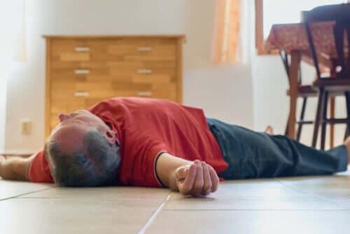 A man lying on the floor unconscious.