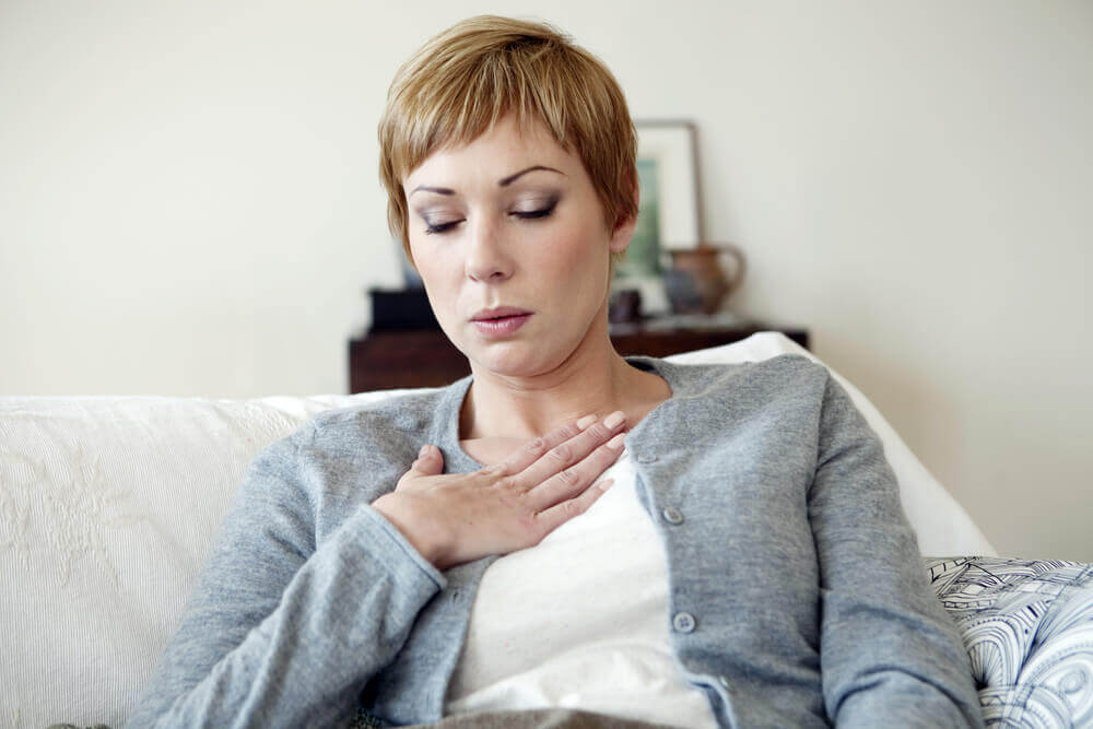 A woman suffering from hot flashes.