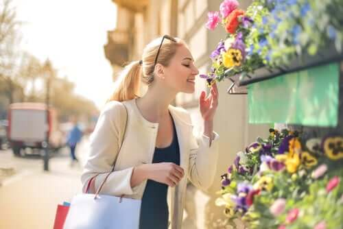 A person smelling flowers.