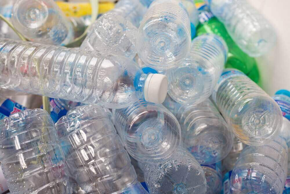 A pile of empty plastic water bottles.