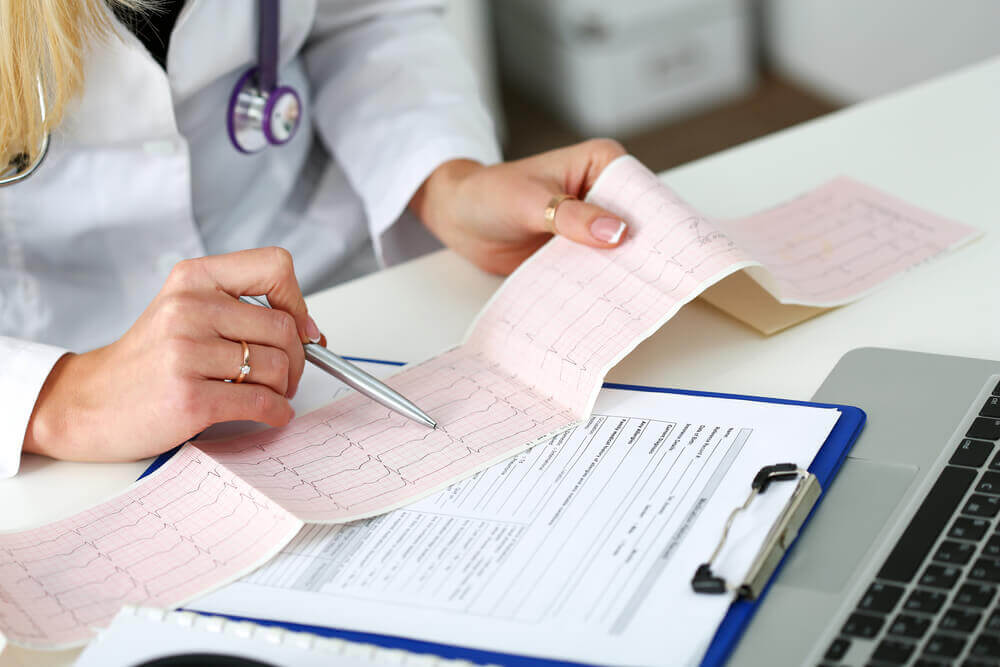 A doctor reading an EKG.