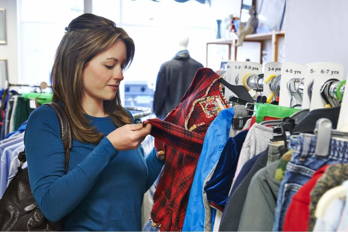 A woman shopping for second hand clothes.