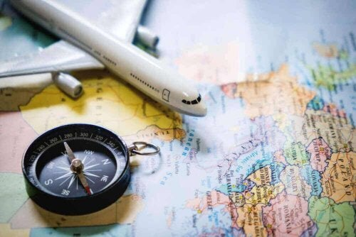A compass, a toy plane and a world map.