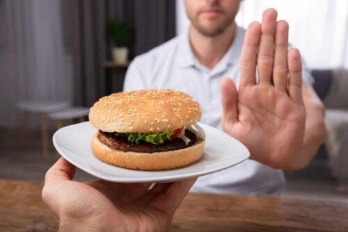 A man rejecting a hamburger.