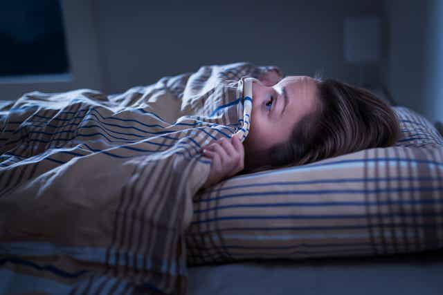 A person having trouble sleeping.
