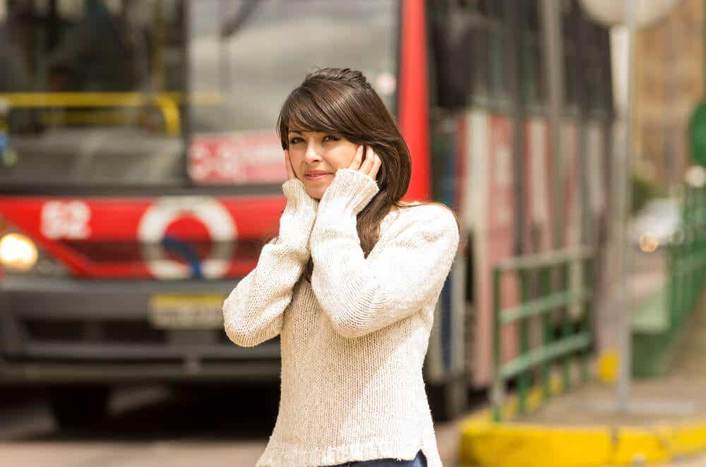 A woman suffering from noise pollution