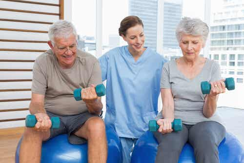 A doctor leading two elderly patients in an exercise routine.