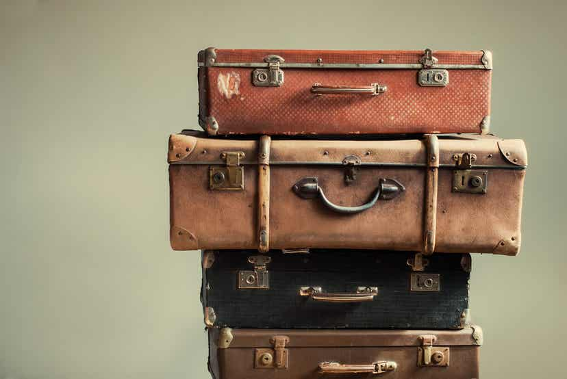 A pile of antique suitcases.
