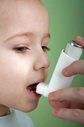 A child with an inhaler.