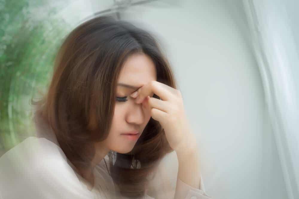 A woman feeling dizzy.