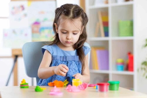 A girl playing with plasticine.